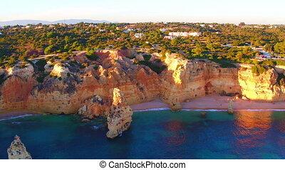 Aerial from natural rocks at Praia da Marinha in Portugal at...