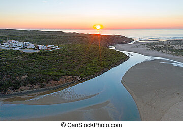 Aerial from Praia Vale Figueiras in Portugal at sunset