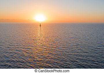 Aerial from sailing on the ocean at sunset