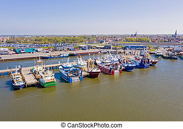 Aerial from the fishing harbor from Harlingen in the Netherlands