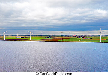 Aerial from windmills at the waterfront in the countryside from the Netherlands