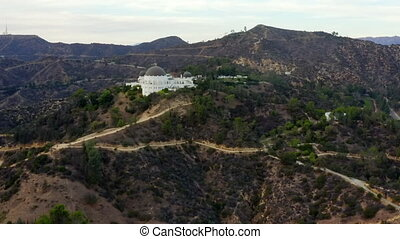 AERIAL: Griffith Observatory with Hollywood Hills in Daylight, Los Angeles, California, Cloudy 4K