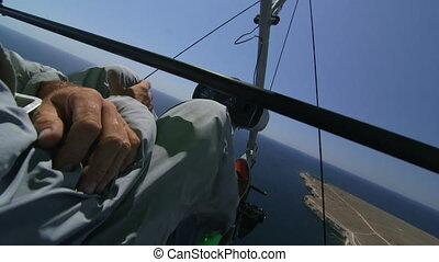 Aerial: Hang glider - Flying over Black sea coast on...