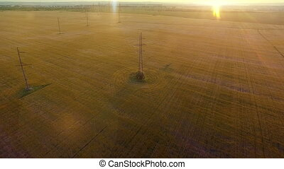 AERIAL High-voltage tower summer warm evening light camera...