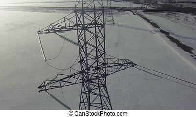 AERIAL High-voltage tower winter cold background