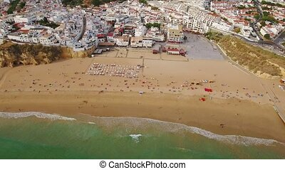 Aerial. Holidaymakers on the beach of the fishermen of...