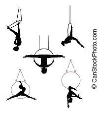 various aerial hoop ring dancers in silhouette