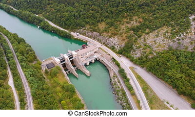 Aerial view producing hydroelectricity river mountains