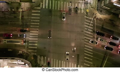 AERIAL HYPER LAPSE: Road Intersection at Night with Car Traffic and City Lights Time Lapse in Los Angeles, California