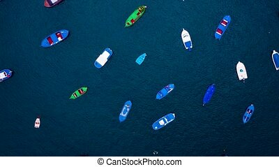 Aerial hyperlapse of anchored boats off the coast. Las...