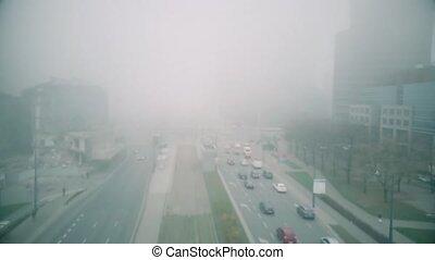 Aerial hyperlapse of city streets in fog - Aerial hyperlapse...