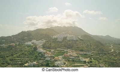 Aerial hyperlapse of small mountainous Spanish town in...