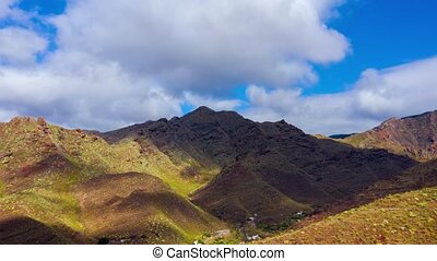 Aerial hyperlapse of the beautiful mountains and clouds on...