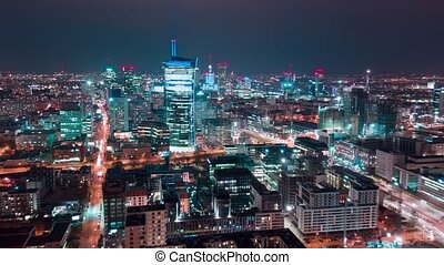 Aerial hyperlapse of Warsaw business center at night:...