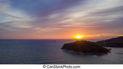 Aerial hyperlapse over the sea during sunset