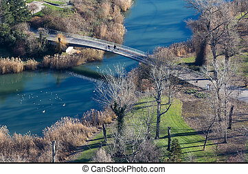 Aerial image of bridge on town river