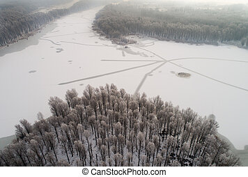 Aerial image of frozen river in forest