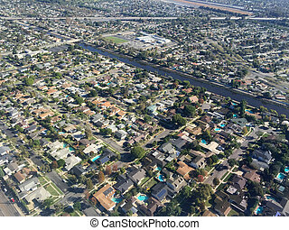Aerial image of homes - An image shot from an airplane shows...