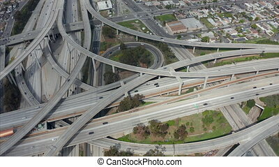 AERIAL: Judge Pregerson Huge Highway Connection showing multiple Roads, Bridges, Viaducts with little car traffic in Los Angeles, California on Beautiful Sunny Day