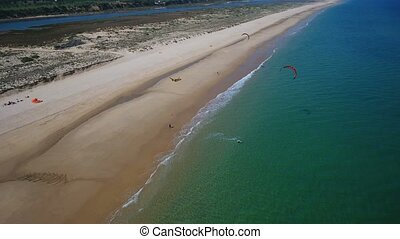 Aerial. Kitesurf on the islands in the sea on Ria Formosa....