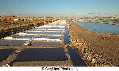 Aerial. Lakes for salt drying in Tavira, lift for work....