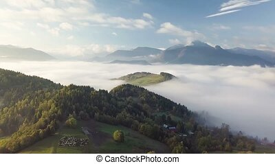 Aerial landing over foggy landscape in colorful autumn morning in rural country