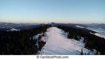 Aerial landscape snow slope with ski elevator in winter ski resort. Winter activity on luxury ski resort drone view