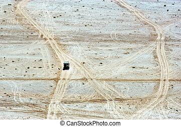 Aerial landscape view of 4WD vehicle journey over off road...