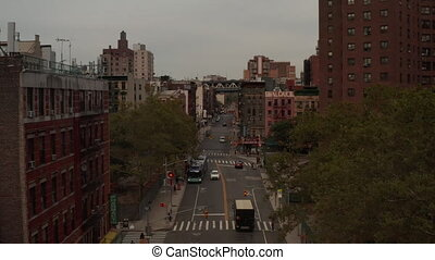 AERIAL: Low flight through Manhattan, New York City street, Chinatown