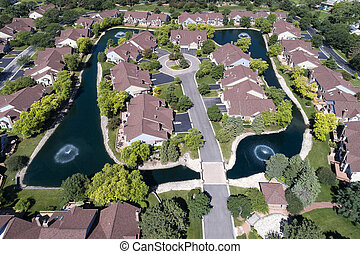 Aerial Luxury Townhouse Complex with Pond