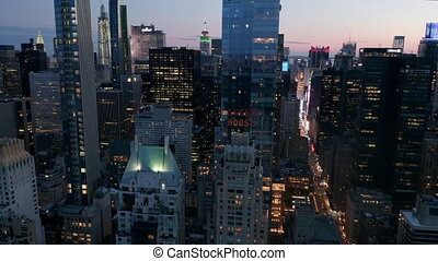 AERIAL: Manhattan Skyline at night with flashing City lights in New York City at Central Park