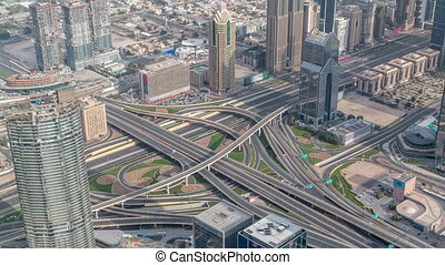 Aerial morning view of highway interchange in Dubai downtown timelapse.