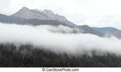 Aerial mountain raining drone fog - Aerial view of sky road...