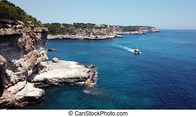 Aerial: Natural arch nearby Cala Santanyi in Mallorca, Spain