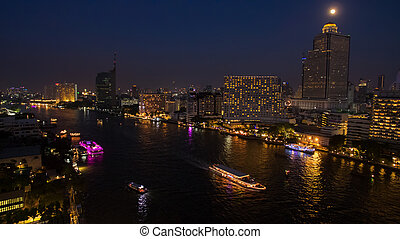 aerial night scene of chaopraya river in heart of bangkok...