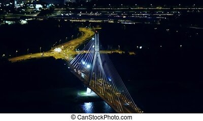 Aerial night shot of the modern guyed bridge over the...