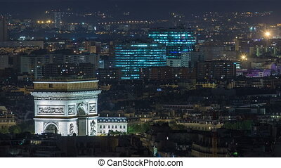 Aerial Night timelapse view of Paris City and Triumphal Arch shot on the top of Eiffel Tower