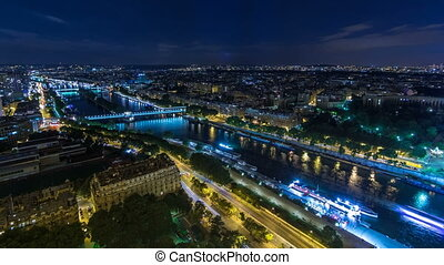 Aerial Night timelapse view of Paris City and Seine river...