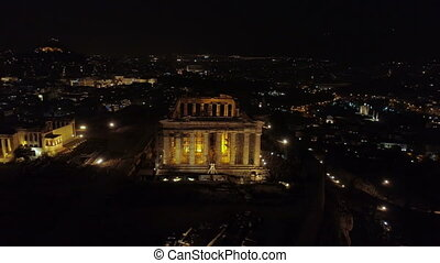 Aerial night video of iconic ancient Acropolis hill and the...