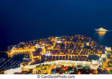 Aerial night view of Dubrovnik Old town and Adriatic Sea