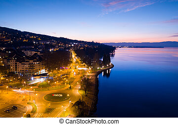 Aerial night view of Evian (Evian-Les-Bains) city in Haute Savoie - France