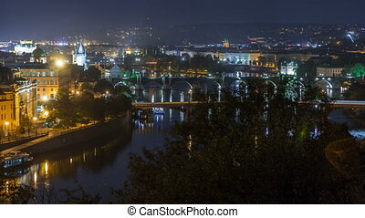 Aerial night view of the Vltava River and illuminated...
