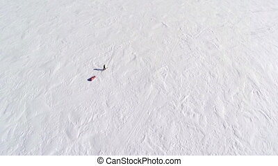 Aerial of a man trekking - An aerial shot of a man that is...