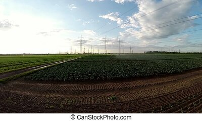 Aerial of a sprinkler system - Aerial video footage of a...