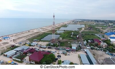 Wonderful 360 degree bird`s eye view of a Black Sea seafront with straight coastline, big square lakes and pools, many private houses, hotels and TV tower in summer