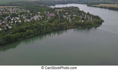 Aerial of Breitenauer See (Lake Breitenau) at Loewenstein, Germany - the lake is closed for the public during the Corona Pandemic in August 2020.