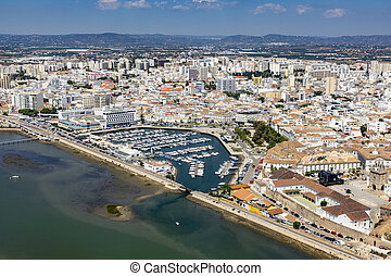 aerial of Faro with harbor, Portugal - aerial of town of ...
