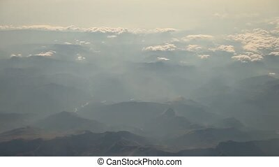 Aerial of flying over Mountains, Alps