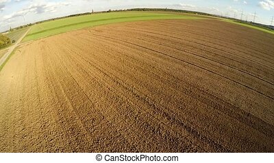 Aerial of harvesting a mais-field in germany - aerial video...