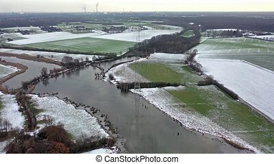 Aerial of high voltage power line pylon in the winter.